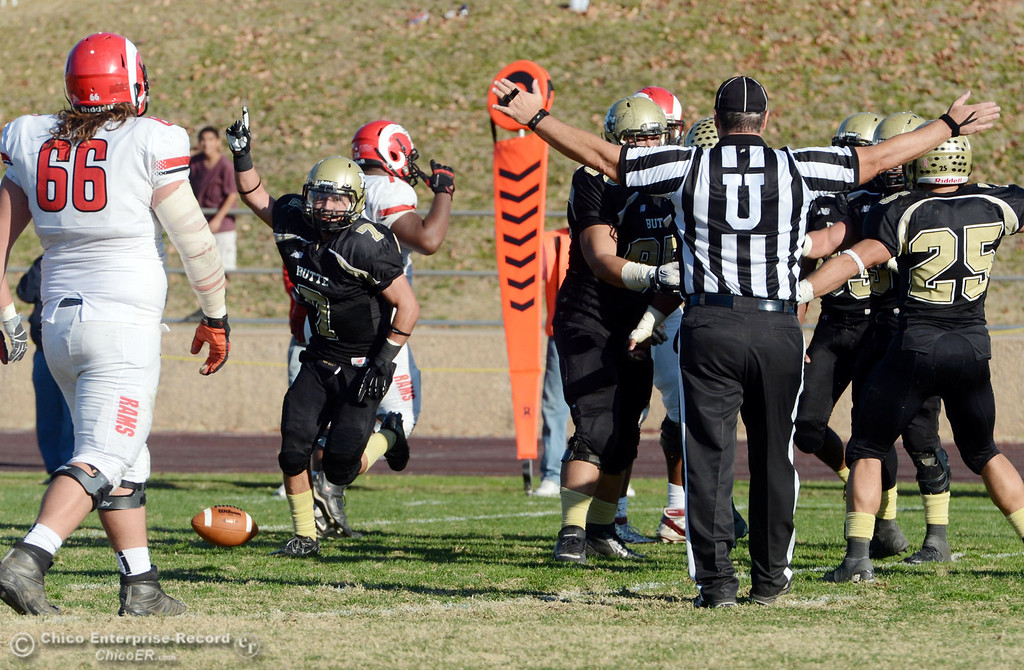 . Butte College\'s #7 Ryan Holland (left) reacts to a possession recovery against Fresno City College in the third quarter of their football game at Butte\'s Cowan Stadium Saturday, November 30, 2013 in Butte Valley, Calif.  (Jason Halley/Chico Enterprise-Record)