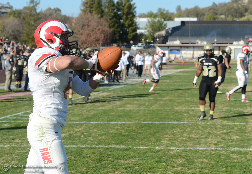 . Fresno City College\'s #5 Brayden Sanchez catches a touchdown pass against Butte College in the third quarter of their football game at Butte\'s Cowan Stadium Saturday, November 30, 2013 in Butte Valley, Calif.  (Jason Halley/Chico Enterprise-Record)