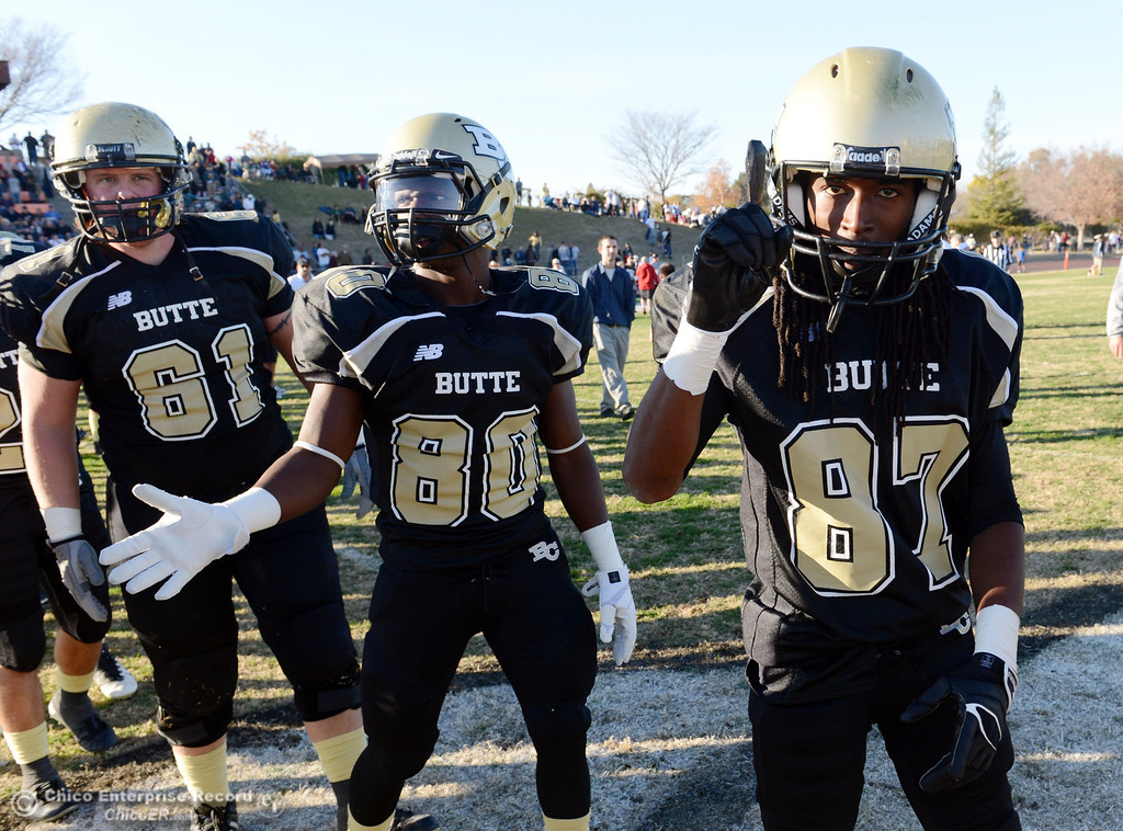 . Butte College\'s #81 Darius Dukes, #80 Jerome Mayfield, and #87 Timazray Shepherd (left to right) celebrate a win against Fresno City College at the end of their football game at Butte\'s Cowan Stadium Saturday, November 30, 2013 in Butte Valley, Calif.  (Jason Halley/Chico Enterprise-Record)