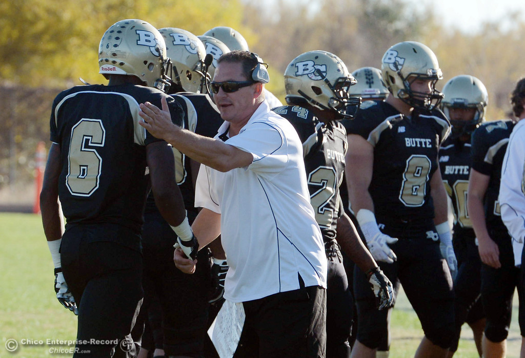 . Butte College coach Tim Garcia (right) congratulates #6 Denzel Conyers (left) against Fresno City College in the fourth quarter of their football game at Butte\'s Cowan Stadium Saturday, November 30, 2013 in Butte Valley, Calif.  (Jason Halley/Chico Enterprise-Record)