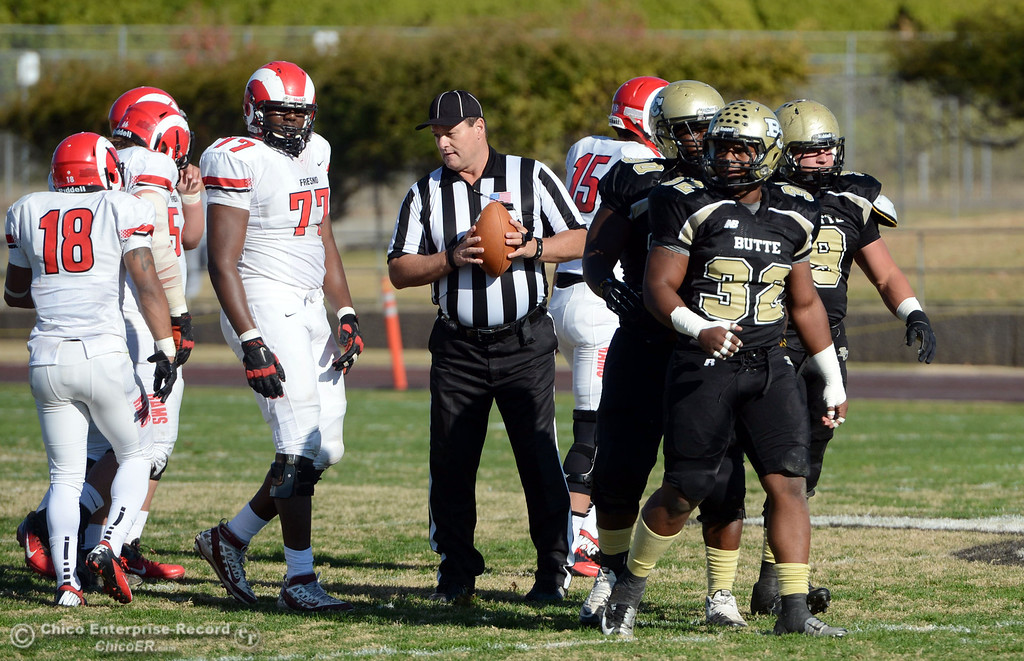 . Butte College\'s #32 Brian Anderson looks on against Fresno City College in the first quarter of their football game at Butte\'s Cowan Stadium Saturday, November 30, 2013 in Butte Valley, Calif.  (Jason Halley/Chico Enterprise-Record)