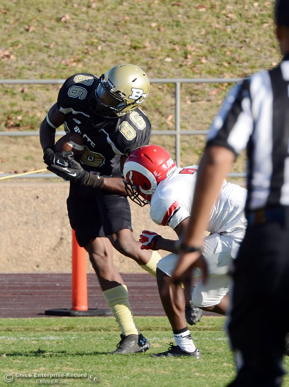 . Butte College\'s #86 Jon Parks (left) catches for a touchdown against Fresno City College\'s #7 Vadal McDonald (right) in the third quarter of their football game at Butte\'s Cowan Stadium Saturday, November 30, 2013 in Butte Valley, Calif.  (Jason Halley/Chico Enterprise-Record)
