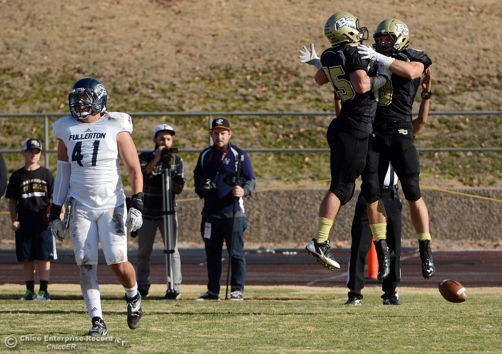 . Butte College\'s #85 Richard Murphy (left) celebrates with #8 Bo Brummel (right) on scoring a touchdown against Fullerton College in the second quarter of their CCCAA football state championship final at Butte\'s Cowan Stadium Saturday, December 14, 2013 in Butte Valley, Calif. (Jason Halley/Chico Enterprise-Record)