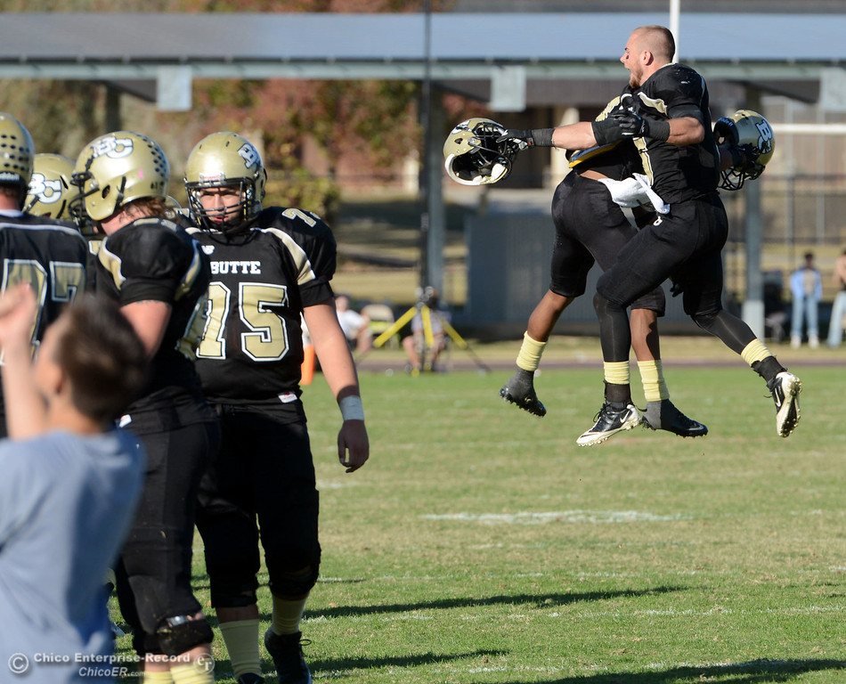 . Butte College\'s #1 Wes McCoy and #9 Tyler Adair (right) celebrate McCoy intercepting a pass against San Mateo College in the fourth quarter of their football game at Butte\'s Cowan Stadium Saturday, November 2, 2013 in Oroville, Calif.  (Jason Halley/Chico Enterprise-Record)