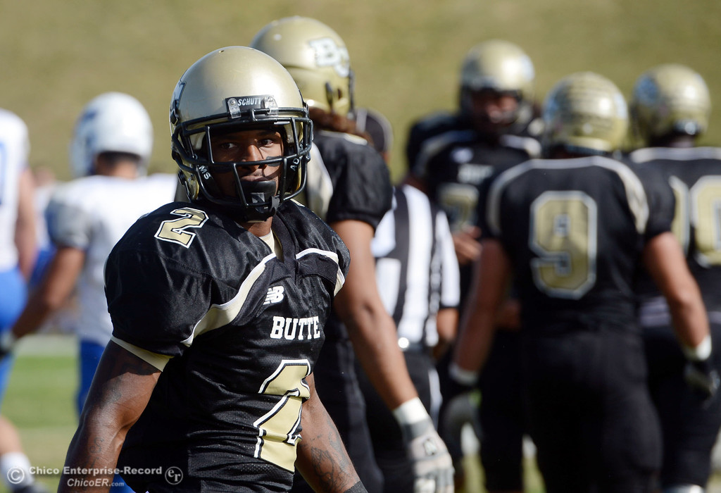 . Butte College\'s #2 Deonte Flemings looks on against San Mateo College in the first quarter of their football game at Butte\'s Cowan Stadium Saturday, November 2, 2013 in Oroville, Calif.  (Jason Halley/Chico Enterprise-Record)