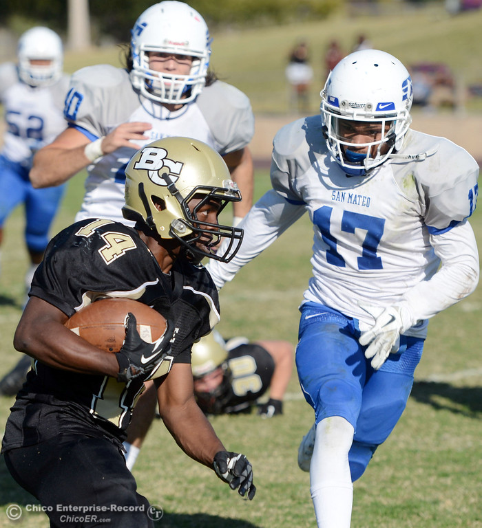 . Butte College\'s #14 Robert Frazier (let) is tackled against College of San Mateo\'s #17 Deshane Hines (right)  in the third quarter of their football game at Butte\'s Cowan Stadium Saturday, November 2, 2013 in Oroville, Calif.  (Jason Halley/Chico Enterprise-Record)