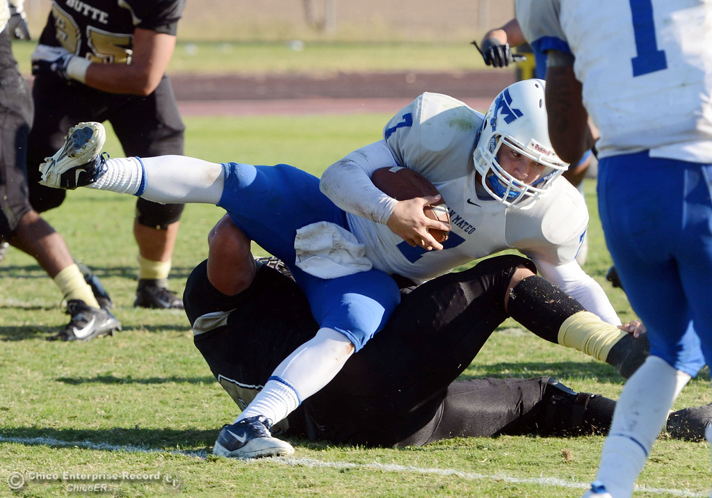 . Butte College\'s #9 Tyler Adair (bottom) sacks against San Mateo College\'s #7 Casey Wichman (top) at the end of the fourth quarter of their football game at Butte\'s Cowan Stadium Saturday, November 2, 2013 in Oroville, Calif.  (Jason Halley/Chico Enterprise-Record)