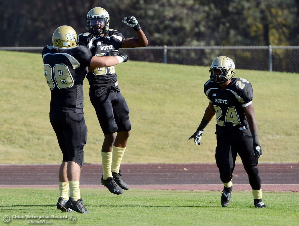 . Butte College\'s #88 Ralph Raetz (left) #86 Jon Parks (right) and #24 Kendall WIlliams (right) reacts to Parks scoring a touchdown against College of San Mateo in the second quarter of their football game at Butte\'s Cowan Stadium Saturday, November 2, 2013 in Oroville, Calif.  (Jason Halley/Chico Enterprise-Record)
