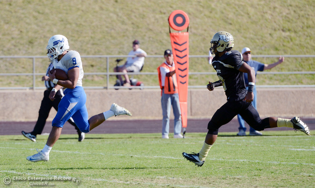 . Butte College\'s #3 London Muse (right) watches College of San Mateo\'s #9 George Naufahu (left) score a touchdown in the second quarter of their football game at Butte\'s Cowan Stadium Saturday, November 2, 2013 in Oroville, Calif.  (Jason Halley/Chico Enterprise-Record)