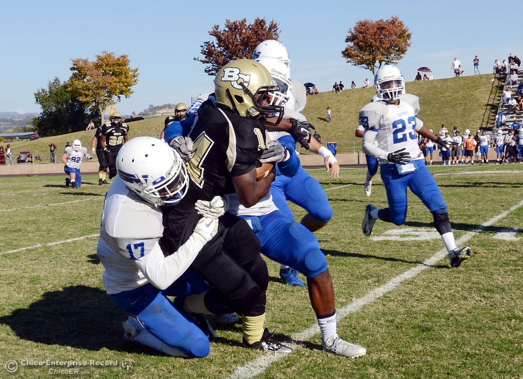 . Butte College\'s #14 Robert Frazier (right) is tackled against College of San Mateo\'s #17 Deshane Hines (left)  in the third quarter of their football game at Butte\'s Cowan Stadium Saturday, November 2, 2013 in Oroville, Calif.  (Jason Halley/Chico Enterprise-Record)