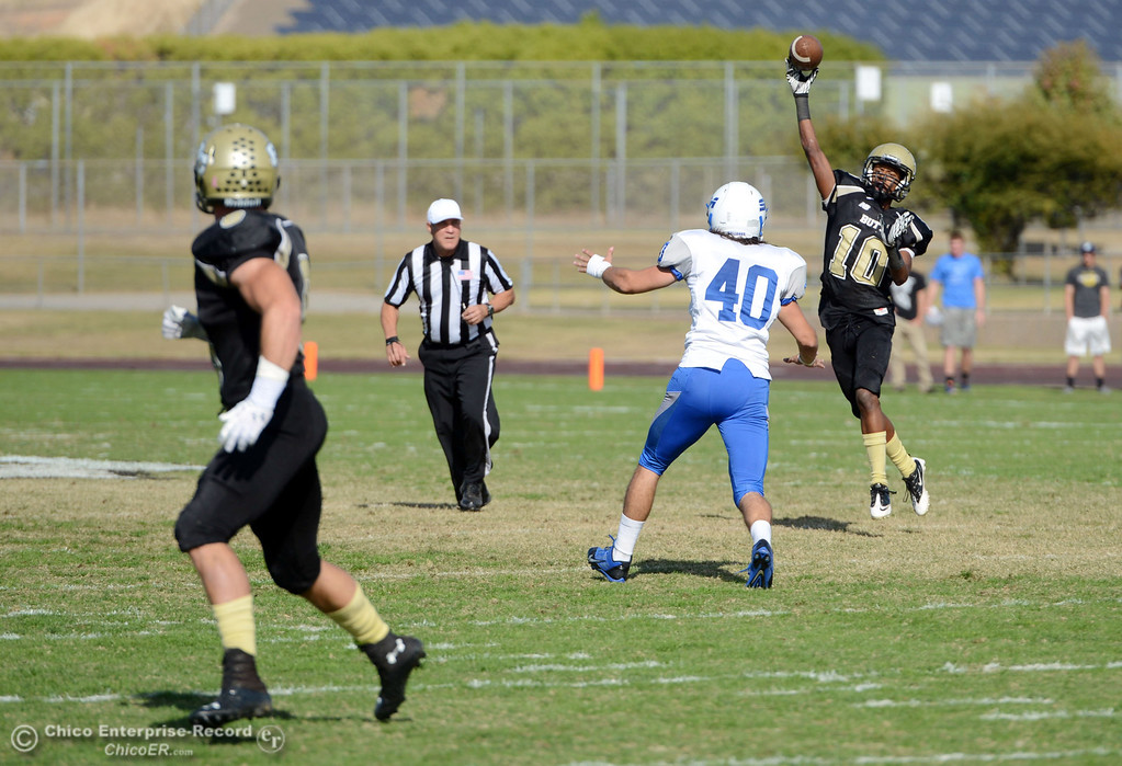 . Butte College\'s #10 CJ Grice (right) throws to #8 Bo Brummel (left) for a touchdown against College of San Mateo\'s #40 Jake Kearney (center) in the second quarter of their football game at Butte\'s Cowan Stadium Saturday, November 2, 2013 in Oroville, Calif.  (Jason Halley/Chico Enterprise-Record)