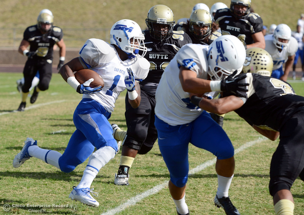 . Butte College\'s #90 Stephen Francois (right) defend against San Mateo College\'s #1 Quincy Nelson (left) in the first quarter of their football game at Butte\'s Cowan Stadium Saturday, November 2, 2013 in Oroville, Calif.  (Jason Halley/Chico Enterprise-Record)