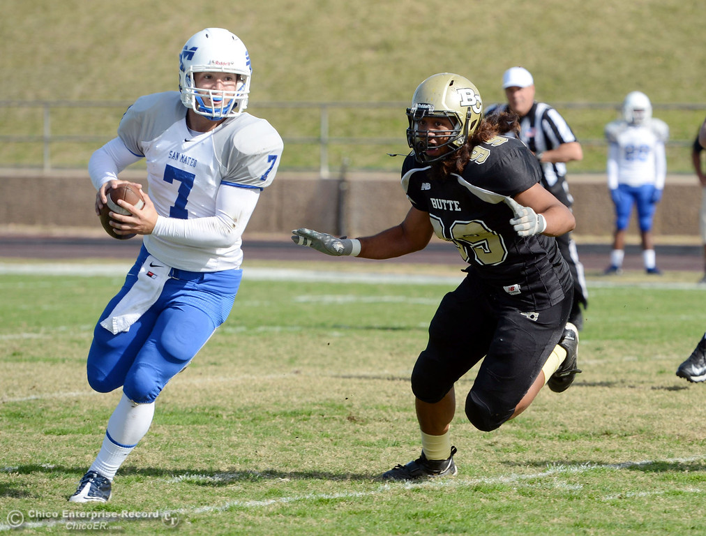 . Butte College\'s #99 Leopeni Siania (right) defends against San Mateo College\'s #7 Casey Wichman (left) in the first quarter of their football game at Butte\'s Cowan Stadium Saturday, November 2, 2013 in Oroville, Calif.  (Jason Halley/Chico Enterprise-Record)