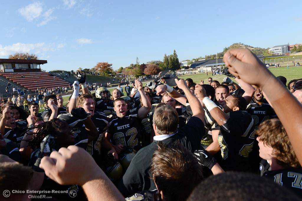 . Butte College coach Jeff Jordan (center) celebrates their win against College of San Mateo at the end of the fourth quarter of their football game at Butte\'s Cowan Stadium Saturday, November 2, 2013 in Oroville, Calif.  (Jason Halley/Chico Enterprise-Record)