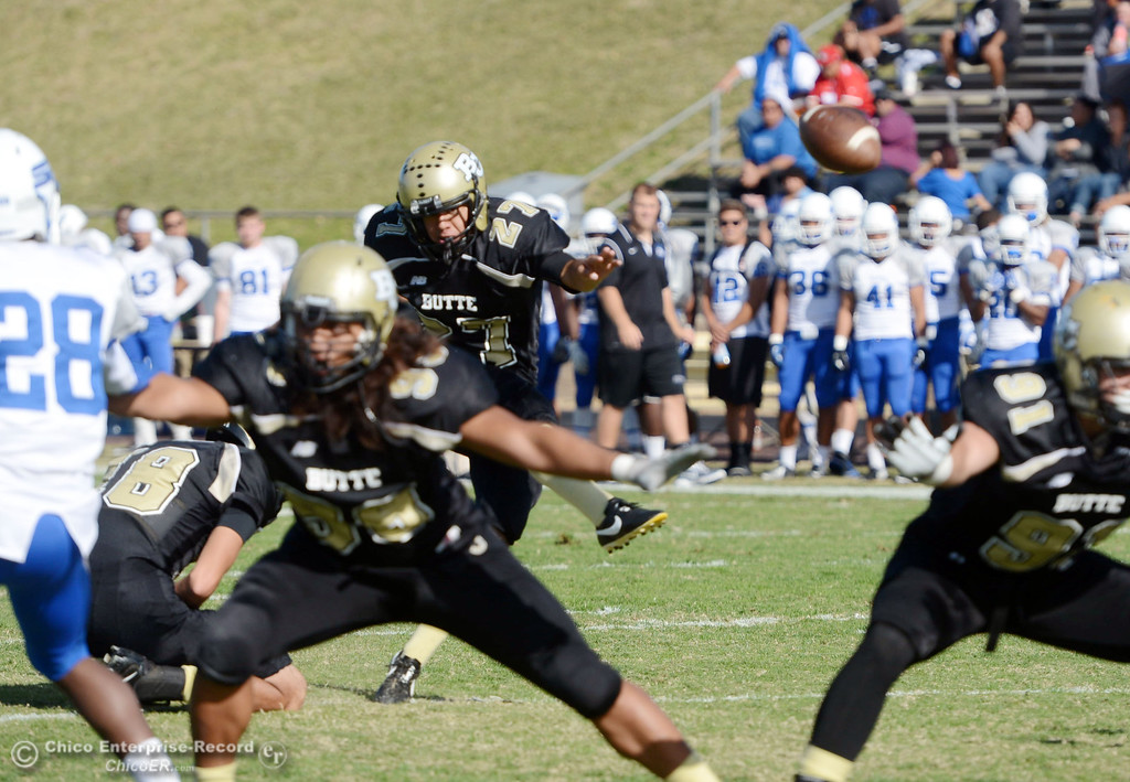 . Butte College\'s #27 Rigoberto Sanchez kicks the extra point against College of San Mateo in the second quarter of their football game at Butte\'s Cowan Stadium Saturday, November 2, 2013 in Oroville, Calif.  (Jason Halley/Chico Enterprise-Record)