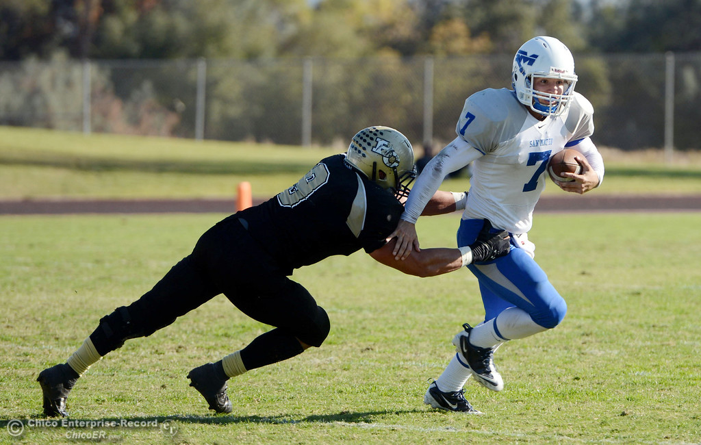 . Butte College\'s #9 Tyler Adair (left) attempts to tackle against College of San Mateo\'s #7 Casey Wichman (right) in the third quarter of their football game at Butte\'s Cowan Stadium Saturday, November 2, 2013 in Oroville, Calif.  (Jason Halley/Chico Enterprise-Record)