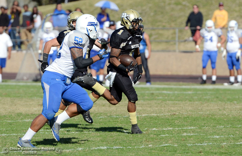 . Butte College\'s #1 Wes McCoy (right) returns a kickoff for a touchdown against College of San Mateo in the third quarter of their football game at Butte\'s Cowan Stadium Saturday, November 2, 2013 in Oroville, Calif.  (Jason Halley/Chico Enterprise-Record)
