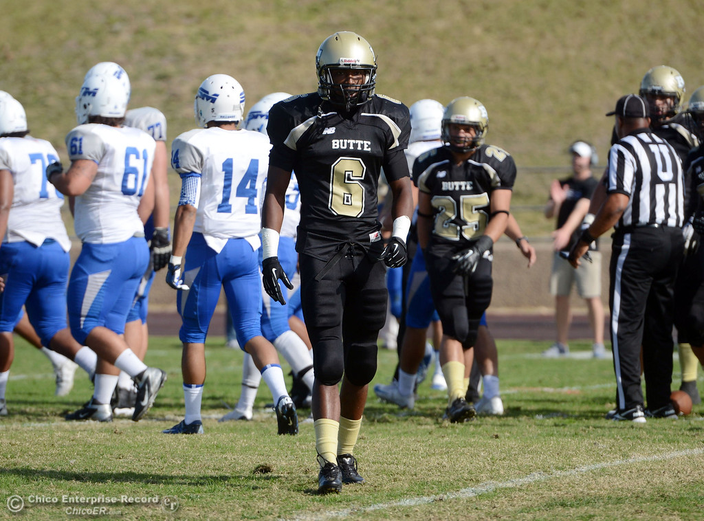. Butte College\'s #6 Denzel Conyers looks on against San Mateo College in the first quarter of their football game at Butte\'s Cowan Stadium Saturday, November 2, 2013 in Oroville, Calif.  (Jason Halley/Chico Enterprise-Record)