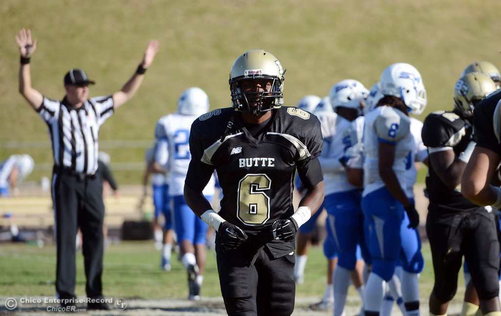 . Butte College\'s #6 Denzel Conyers looks on against College of San Mateo in the third quarter of their football game at Butte\'s Cowan Stadium Saturday, November 2, 2013 in Oroville, Calif.  (Jason Halley/Chico Enterprise-Record)