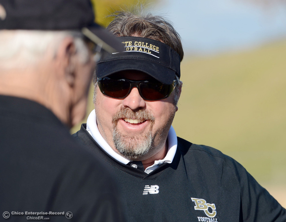 . Butte College coach Jeff Jordan smiles after a win against College of San Mateo in of their football game at Butte\'s Cowan Stadium Saturday, November 2, 2013 in Oroville, Calif.  (Jason Halley/Chico Enterprise-Record)