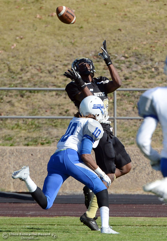 . Butte College\'s #86 Jon Parks (right) catches for a touchdown against San Mateo College\'s #10 Joseph Turner (left) in the second quarter of their football game at Butte\'s Cowan Stadium Saturday, November 2, 2013 in Oroville, Calif.  (Jason Halley/Chico Enterprise-Record)