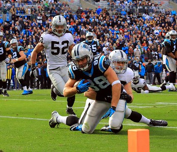2012 December 23: (88) Greg Olsen, Tight End gets taken down by (56) Miles Burris, LB just shy of the goal line during the Carolina Panthers vs Oakland Raiders game at Bank Of America Stadium in Charlotte NC.