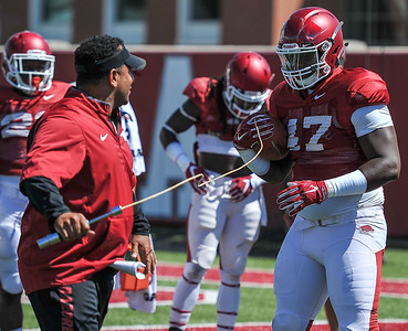 Anthony Brown with Coach Jemal Singleton at the Razorback football practice on Thursday, August 20, 2015 at the Fred W. Smith Football Center in Fayetteville, Arkansas.   (Alan Jamison, Nate Allen Sports Service).