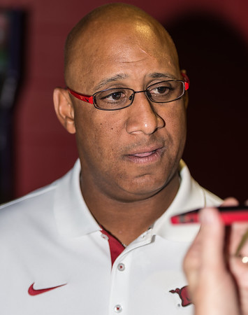 Coach Michael Smith  meets with media at the Razorback Media Day on Sunday, August 9, 2015 at the Fred W. Smith Football Center in Fayetteville, Arkansas.   (Alan Jamison, Nate Allen Sports Service).