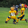 Alec Ogano makes a nice open field tackle.