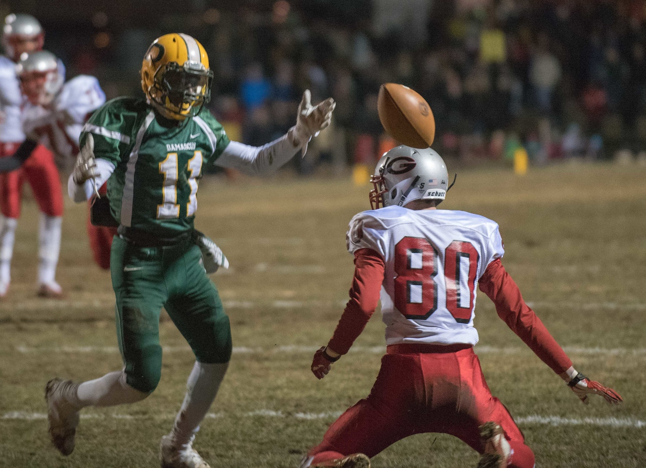 Before teh ball even hits the ground, Ari Cacopardo is in #80's face about pass interference.