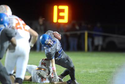 Danville's Ken Cooper tries to tackle Warrior Run's Matthew Gummo during Friday's game.
