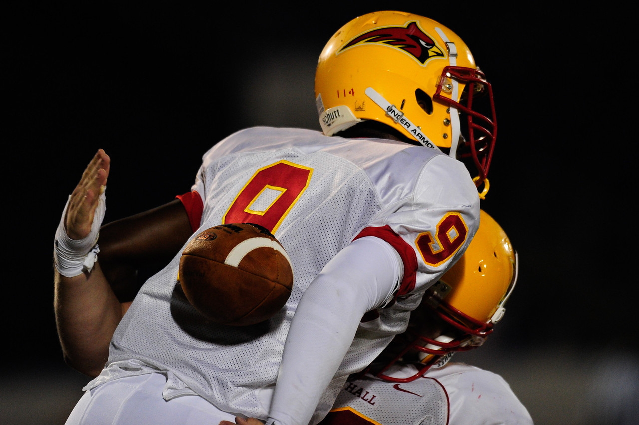 Sept 9, 2011 : Calvert Hall's WR Kyle Levere (9) gets hit in the back with a pass during action at the 2011 Patriot Classic Football tournament at the United States Naval Academy Stadium in Annapolis, Maryland. Calvert Hall dominated and came away with a 18-0 victory over DeMatha.