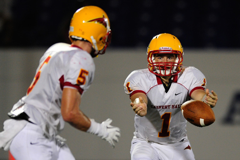 Sept 9, 2011 : Calvert Hall's quarterback Thomas Stuart (1) passes to teammate CJ Williams (5)  during action at the 2011 Patriot Classic Football tournament at the United States Naval Academy Stadium in Annapolis, Maryland. Calvert Hall dominated and came away with a 18-0 victory over DeMatha.