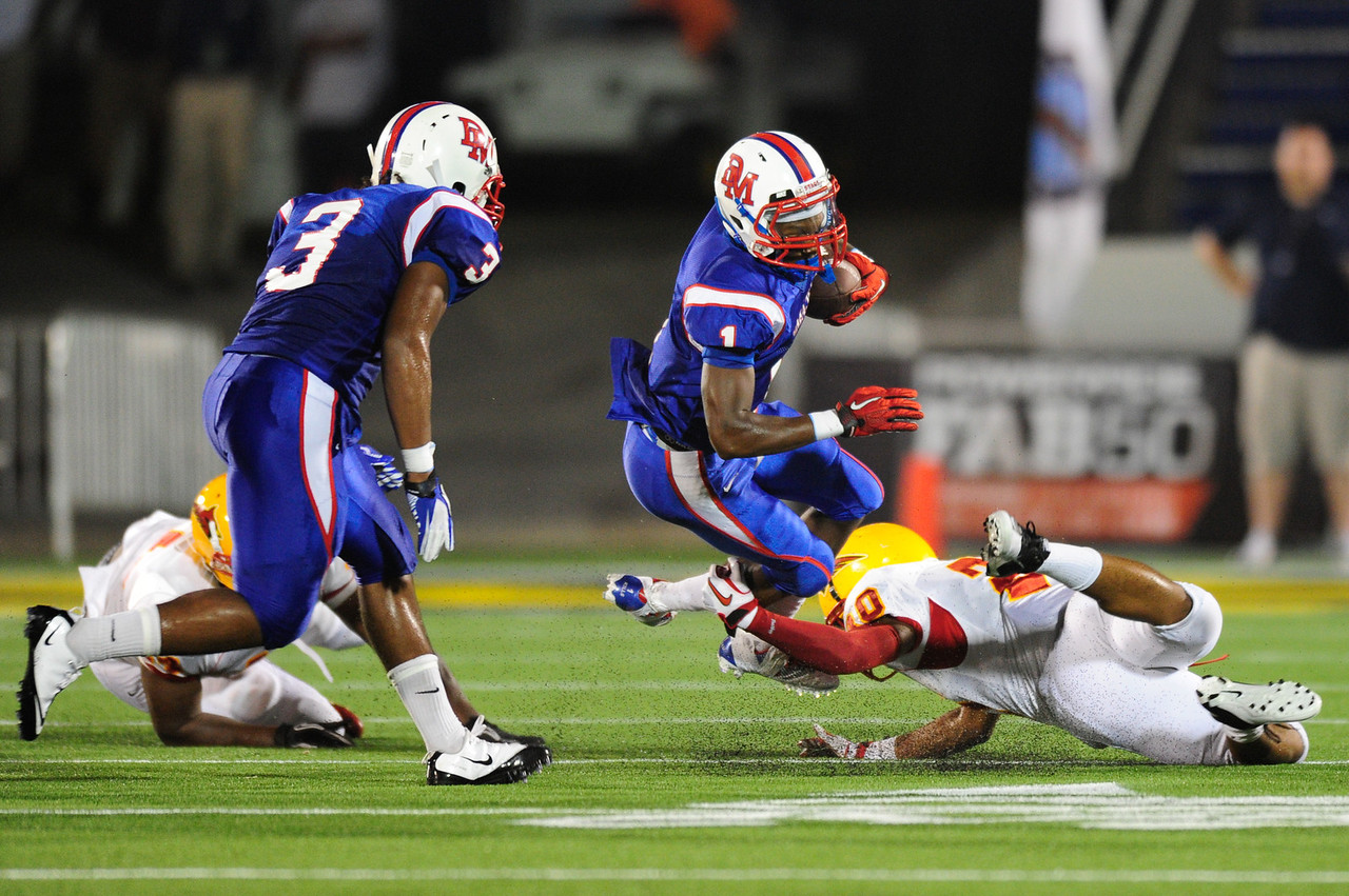 Sept 9, 2011 : DeMatha's Charlie Jordan (10 during action at the 2011 Patriot Classic Football tournament at the United States Naval Academy Stadium in Annapolis, Maryland. Calvert Hall dominated and came away with a 18-0 victory over DeMatha.