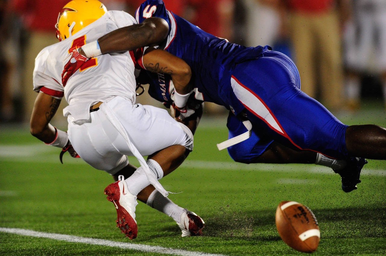 Sept 9, 2011 : Calvert Hall's Charles Jordan (1) gets tackled during action at the 2011 Patriot Classic Football tournament at the United States Naval Academy Stadium in Annapolis, Maryland. Calvert Hall dominated and came away with a 18-0 victory over DeMatha.