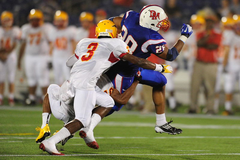 Sept 9, 2011 : DeMatha's RB Taiwan Deal (28) tries to avoid tackle from Calvert Hall's Daquan Davis (3) during action at the 2011 Patriot Classic Football tournament at the United States Naval Academy Stadium in Annapolis, Maryland. Calvert Hall dominated and came away with a 18-0 victory over DeMatha.