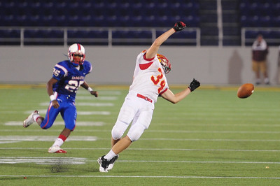 Sept 9, 2011 : Calvert Hall's Josh Ceribelli (34) is overthrown during action at the 2011 Patriot Classic Football tournament at the United States Naval Academy Stadium in Annapolis, Maryland. Calvert Hall dominated and came away with a 18-0 victory over DeMatha.