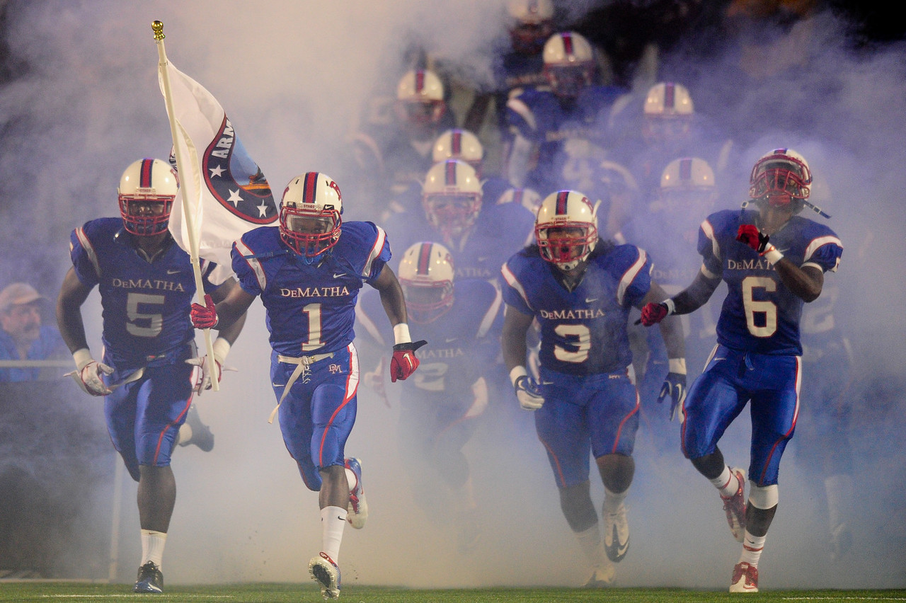 Sept 9, 2011 : DeMatha's Charles Jordan (1) brings in the flag before action at the 2011 Patriot Classic Football tournament at the United States Naval Academy Stadium in Annapolis, Maryland. Calvert Hall dominated and came away with a 18-0 victory over DeMatha.