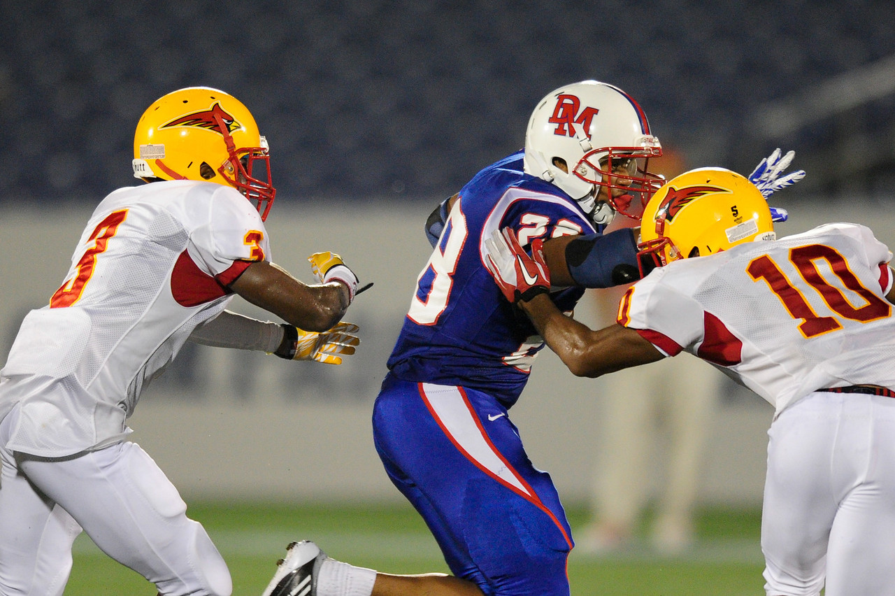 Sept 9, 2011 : DeMatha's RB Taiwan Deal (28) tries to stiff arm Calvert Hall tackler Trevor Williams (10) during action at the 2011 Patriot Classic Football tournament at the United States Naval Academy Stadium in Annapolis, Maryland. Calvert Hall dominated and came away with a 18-0 victory over DeMatha.