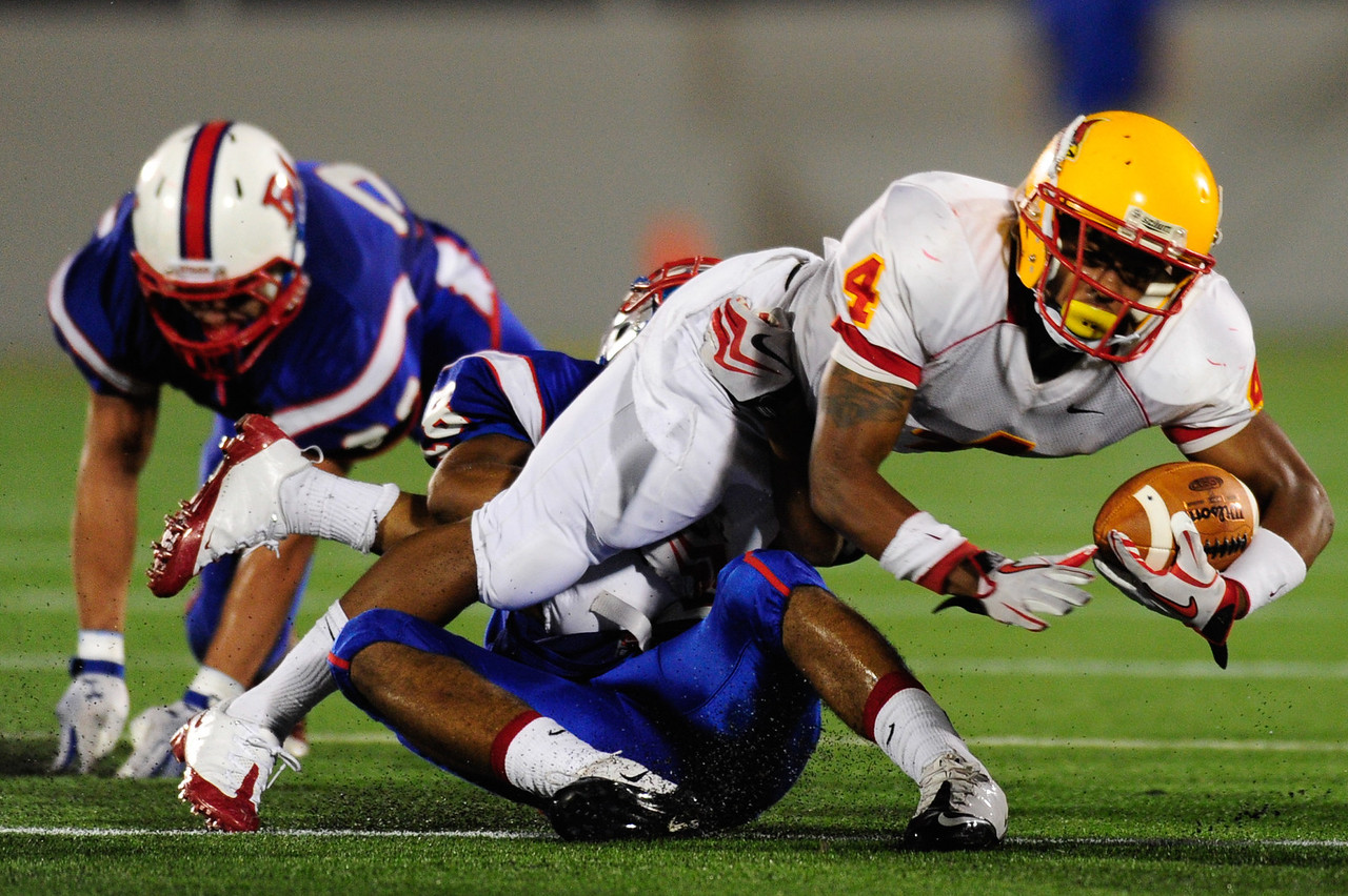Sept 9, 2011 : Calvert Hall's Brandon Neverdon (4) during action at the 2011 Patriot Classic Football tournament at the United States Naval Academy Stadium in Annapolis, Maryland. Calvert Hall dominated and came away with a 18-0 victory over DeMatha.