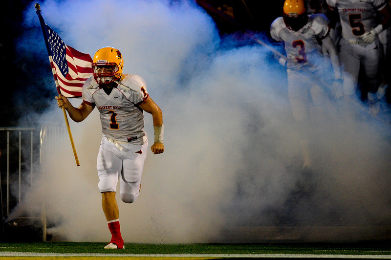 Sept 9, 2011 : Thomas Stuart (1) of Calvert Hall brings the American Flag into the stadium before action at the 2011 Patriot Classic Football tournament at the United States Naval Academy Stadium in Annapolis, Maryland. Calvert Hall dominated and came away with a 18-0 victory over DeMatha.