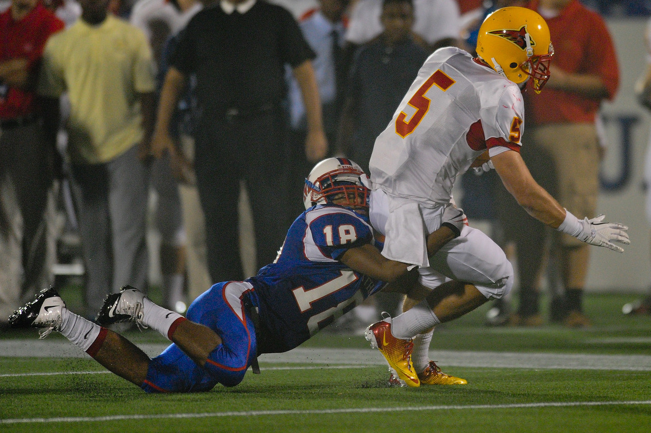 Sept 9, 2011 : Dematha's Cameron Ramirez (18) tackles Calvert Hall's Chet (CJ) Williams (5) during action at the 2011 Patriot Classic Football tournament at the United States Naval Academy Stadium in Annapolis, Maryland. Calvert Hall dominated and came away with a 18-0 victory over DeMatha.