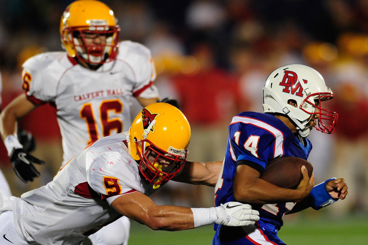 Sept 9, 2011 : DeMatha's Demory Monroe (14) tries to out run Calvert Hall's Kyle Levere (9) during action at the 2011 Patriot Classic Football tournament at the United States Naval Academy Stadium in Annapolis, Maryland. Calvert Hall dominated and came away with a 18-0 victory over DeMatha.