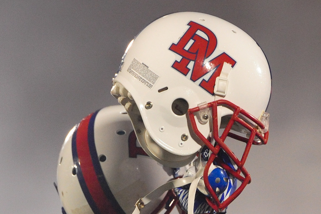 Sept 9, 2011 : Helmets of DeMatha players are lifted high after the National Anthem prior to action at the 2011 Patriot Classic Football tournament at the United States Naval Academy Stadium in Annapolis, Maryland. Calvert Hall dominated and came away with a 18-0 victory over DeMatha.