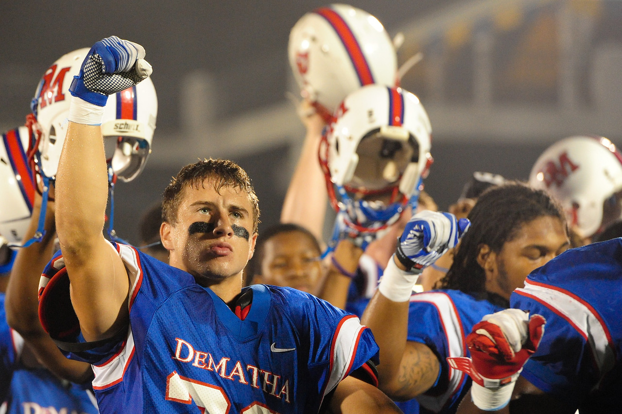 Sept 9, 2011 : Members of DeMatha's team raise their helmets after the playing of the National Anthem before action at the 2011 Patriot Classic Football tournament at the United States Naval Academy Stadium in Annapolis, Maryland. Calvert Hall dominated and came away with a 18-0 victory over DeMatha.
