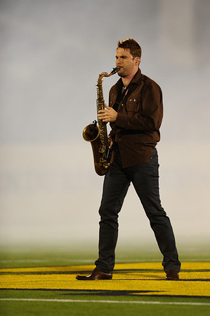 Sept 9, 2011 : DeMatha 1995 graduate David Tauler belts out the National Anthem prior to action at the 2011 Patriot Classic Football tournament at the United States Naval Academy Stadium in Annapolis, Maryland. Calvert Hall dominated and came away with a 18-0 victory over DeMatha.