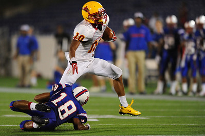 Sept 9, 2011 : Calvert Hall's Trevor Williams (10) tries to escape a tackle during action at the 2011 Patriot Classic Football tournament at the United States Naval Academy Stadium in Annapolis, Maryland. Calvert Hall dominated and came away with a 18-0 victory over DeMatha.