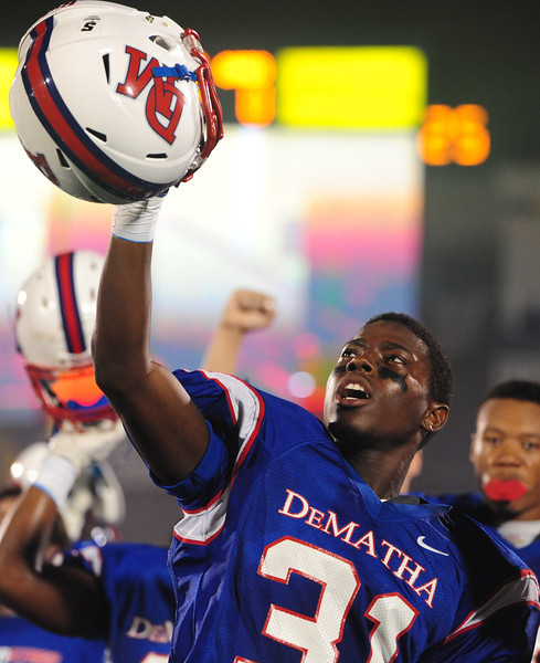 Sept 9, 2011 : Brian Charles (31) of DeMatha raises his helmet after the National Anthem is played beforeaction at the 2011 Patriot Classic Football tournament at the United States Naval Academy Stadium in Annapolis, Maryland. Calvert Hall dominated and came away with a 18-0 victory over DeMatha.