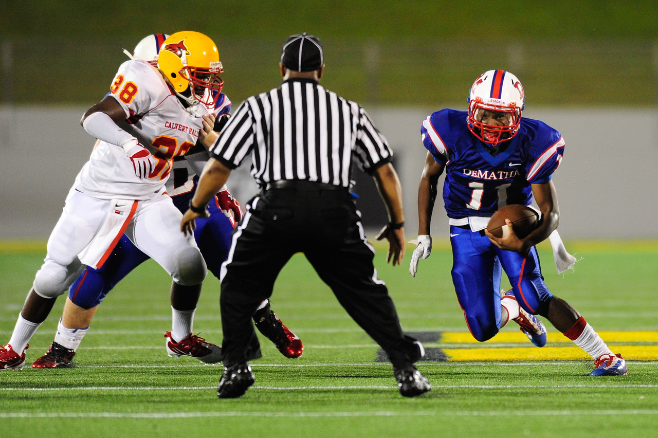 Sept 9, 2011 : DeMatha's sophomore QB Ishmiel Seisay (11) scrambles during action at the 2011 Patriot Classic Football tournament at the United States Naval Academy Stadium in Annapolis, Maryland. Calvert Hall dominated and came away with a 18-0 victory over DeMatha.