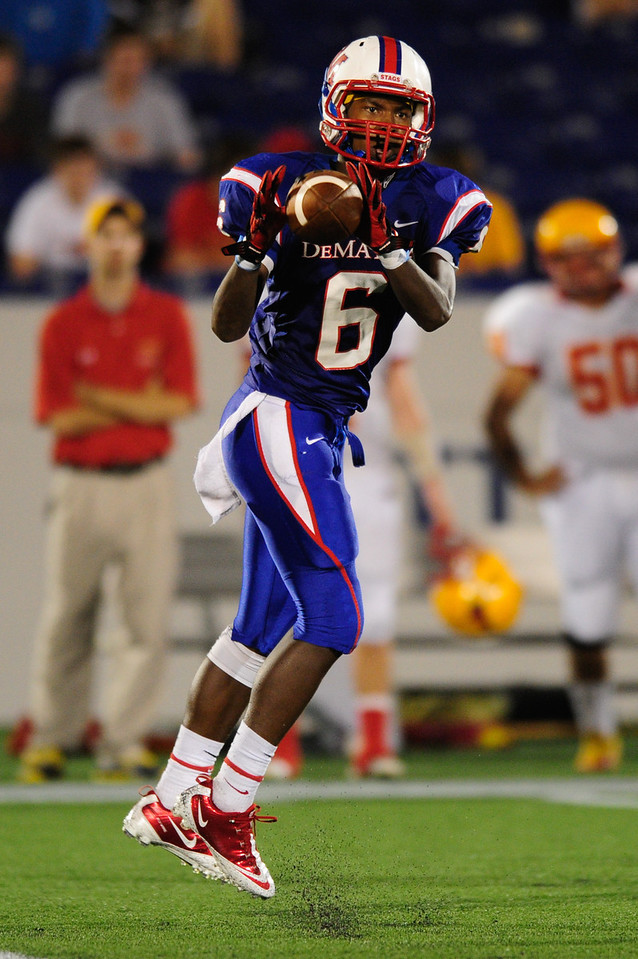 Sept 9, 2011 : DeMatha's WR Jamal Robinson (6) catches a pass during action at the 2011 Patriot Classic Football tournament at the United States Naval Academy Stadium in Annapolis, Maryland. Calvert Hall dominated and came away with a 18-0 victory over DeMatha.
